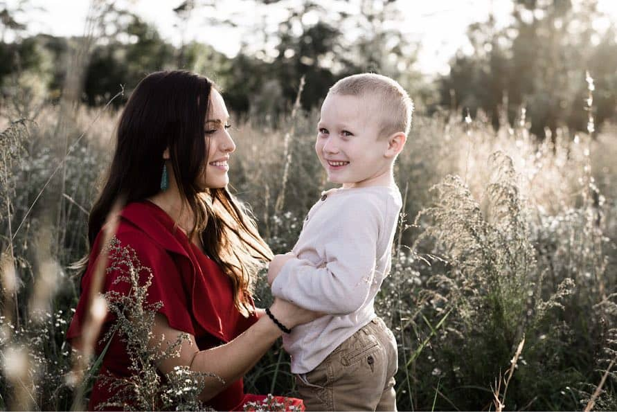 mother and son in golden hour light