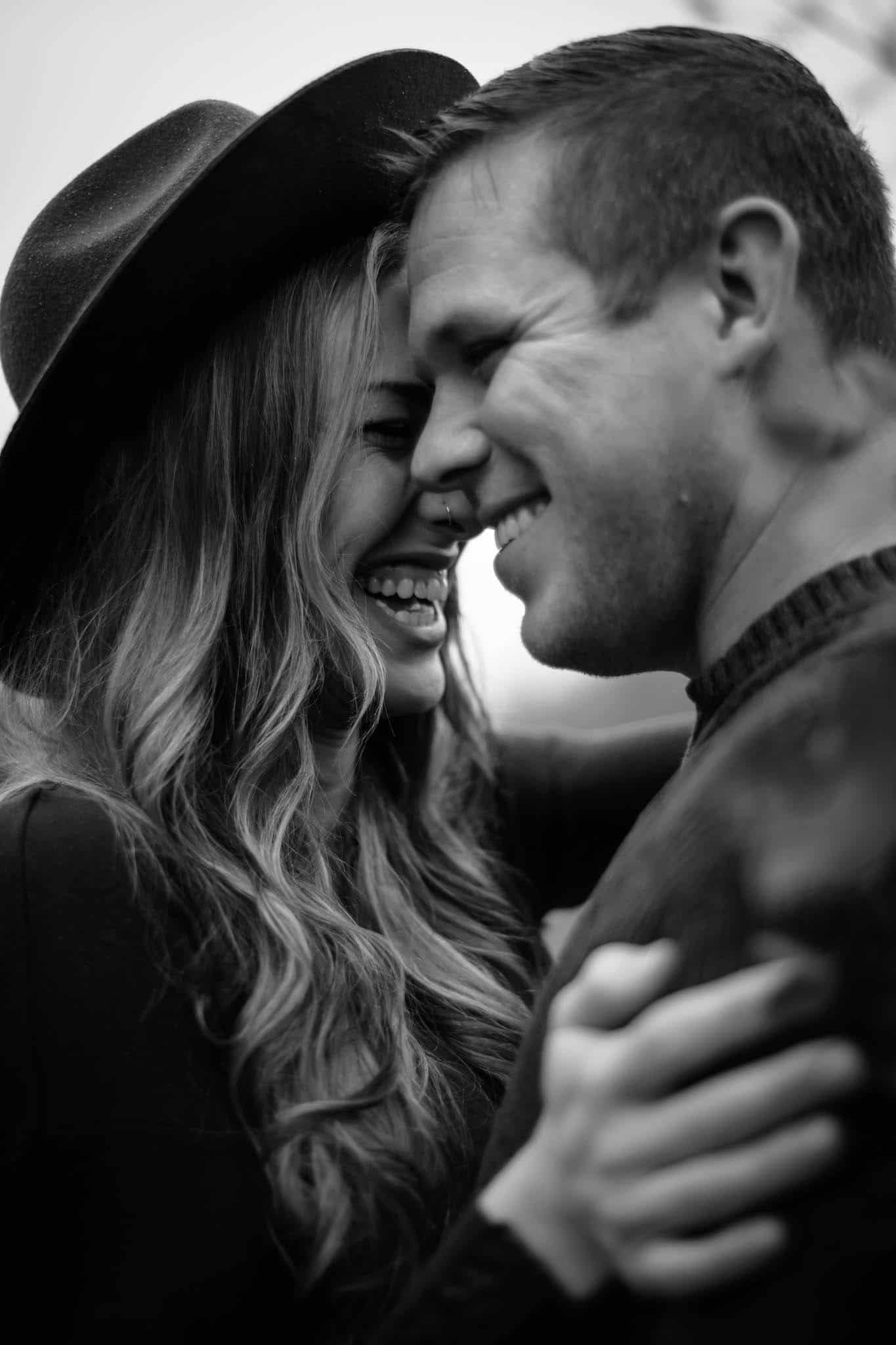 black and white candid of couple laughing