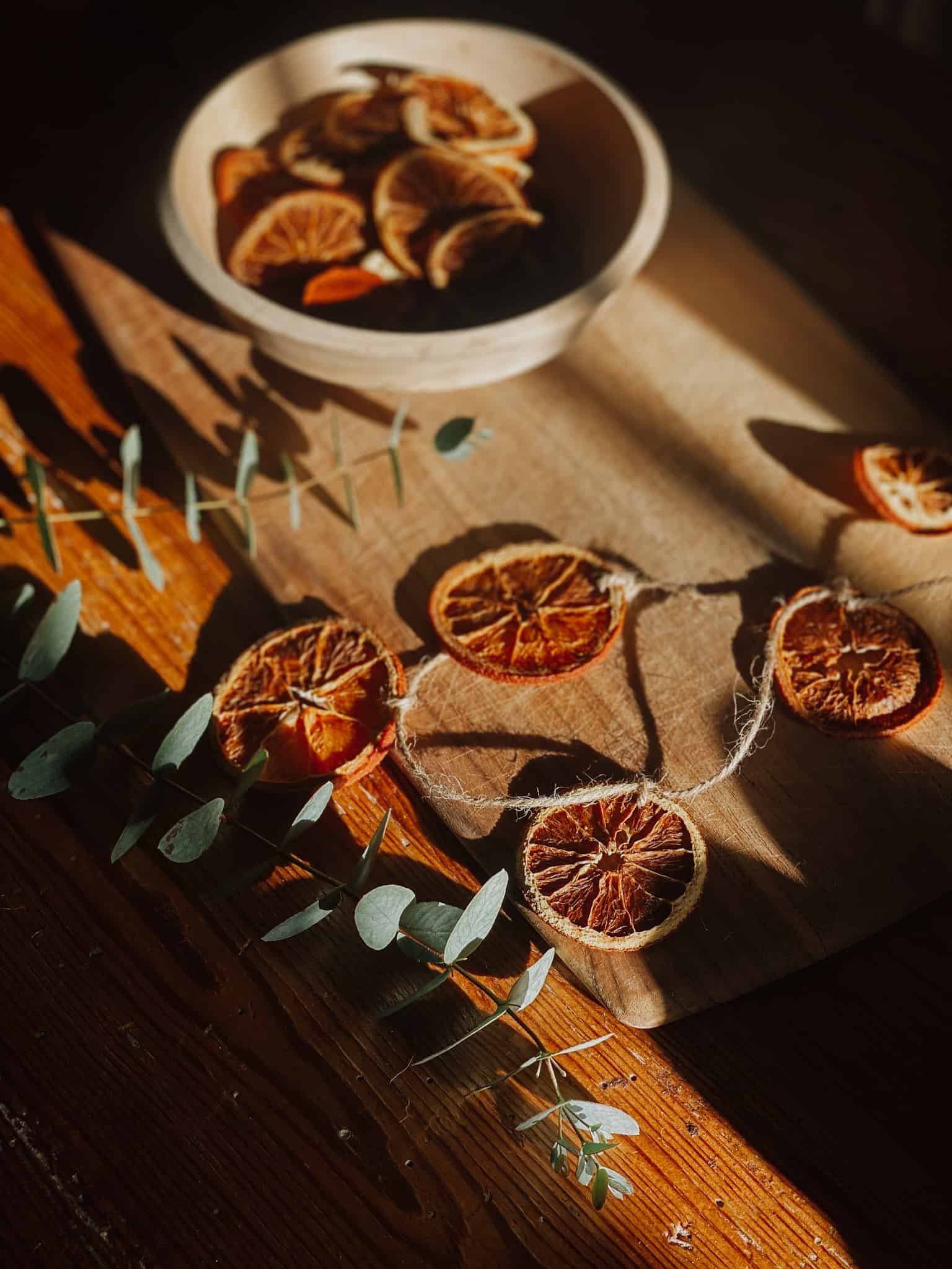 homemade dried orange garland and eucalyptus branches