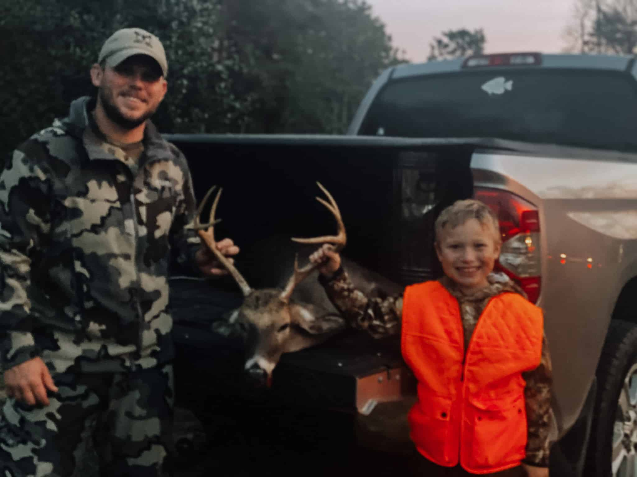 deer hunting father and son with North Carolina buck