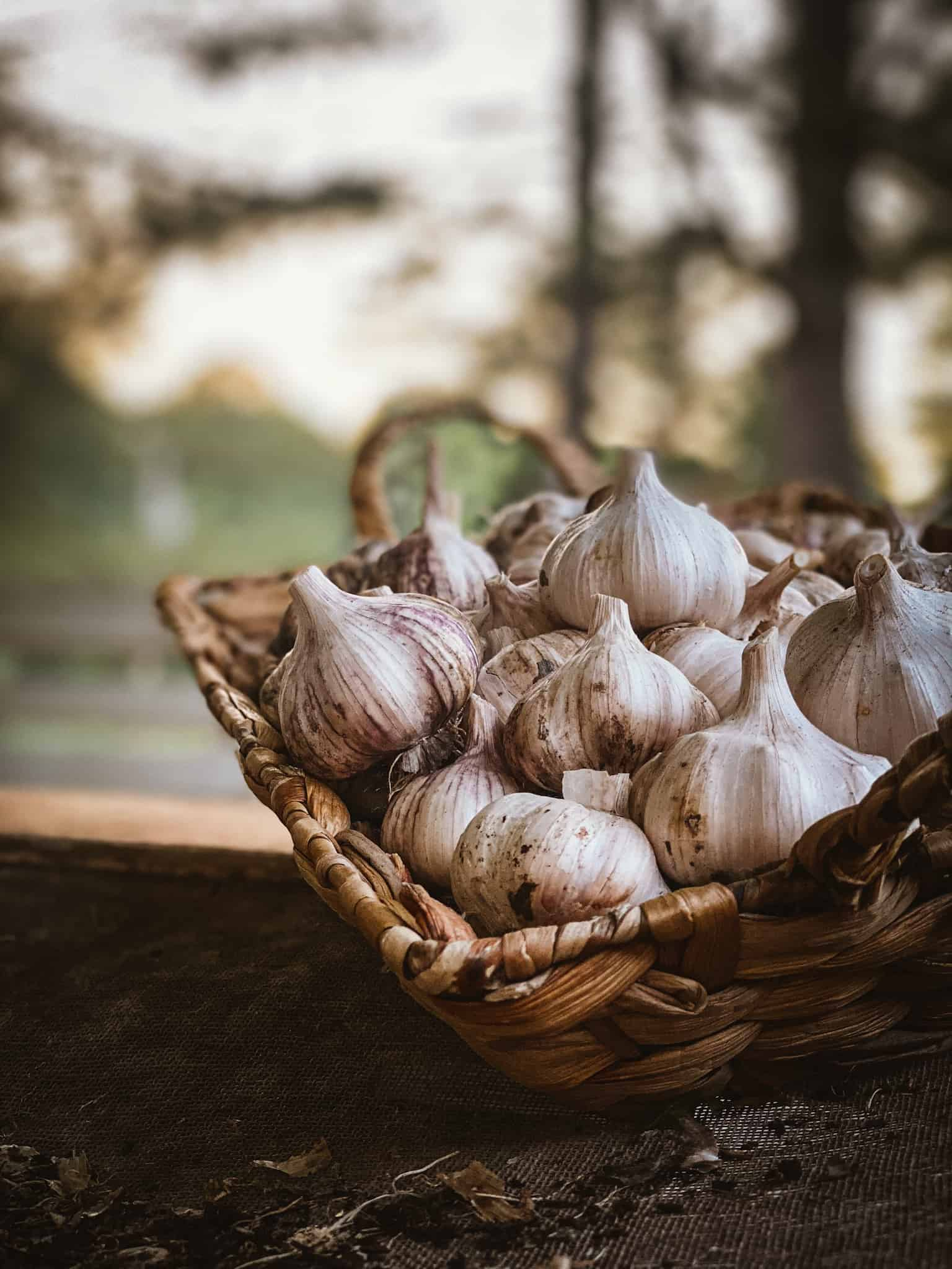 garlic cloves in a wicker basket
